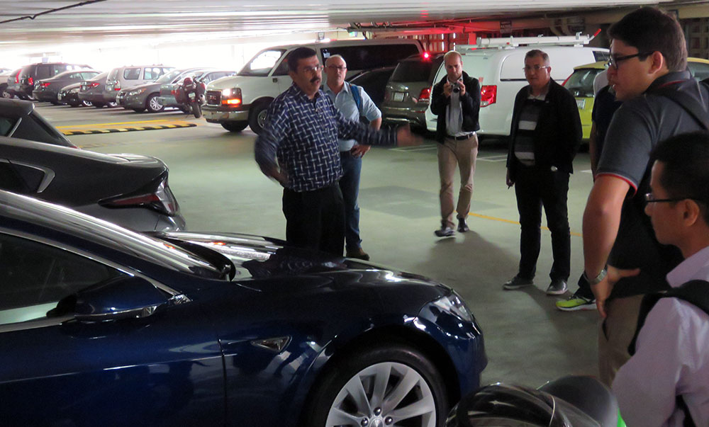 Rajit Gadh discussing SMERC's EV chargers in Parking Structure 8